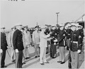 Photograph of President Truman returning a rifle to a Marine after inspecting it, as other Marines stand at... - NARA - 200215.tif
