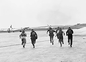 Scrambling (military) - Pilots running to their Hawker Hurricane aircraft during the Battle of Britain