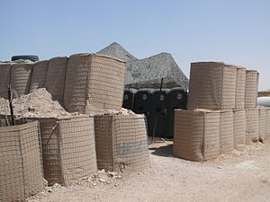Hesco bastion - HESCO bastions stacked two units high around portable toilets in Iraq.