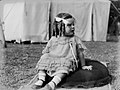 Portrait of a toddler girl seated on the grass (AM 85174-1).jpg