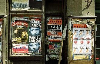 Ozzy Osbourne - Ozzfest concert poster (middle) on a storefront door in Prague, Czech Republic (Summer 2002)