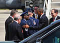 President Barack Obama, second from right, exchanges greetings with U.S. Air Force Chief Master Sgt. Maurice Williams, center left, the command chief of the 145th Airlift Wing, North Carolina Air National Guard 140826-Z-FY745-147.jpg