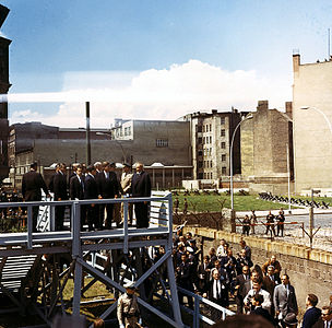 President John F. Kennedy inspects the Berlin Wall during his visit to West Berlin.jpg