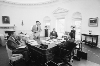 Wilson desk -  Richard Nixon meeting with chief advisers around the Wilson desk in the Oval Office.