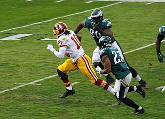 Dual-threat quarterback - Robert Griffin III rushing on a read-option play