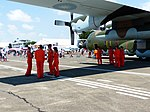 ROCAF Airmen Standing under the Wing of C-130H 1315 20130810.jpg