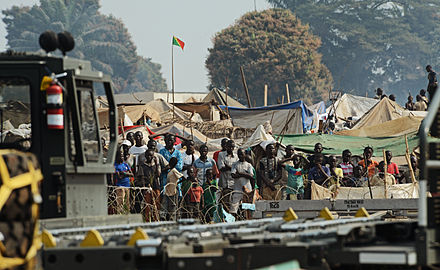 Refugees of the fighting in the Central African Republic, January 2014 Refugees of the fighting in the Central African Republic observe Rwandan soldiers being dropped off at Bangui M'Poko International Airport in the Central African Republic Jan. 19, 2014 140119-F-RN211-760.jpg
