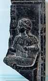 Fragmentary Neo-Sumerian steatite relief showing Ninsun