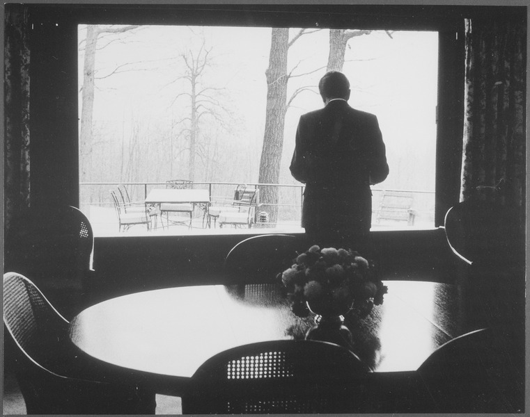 File:Richard M. Nixon standing in front of a window inside the Camp David lodge. - NARA - 194468.tif