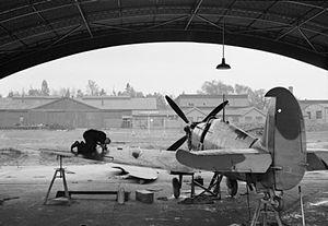 London Biggin Hill Airport - An armourer adjusting machine guns on a Spitfire at Biggin Hill during the Second World War
