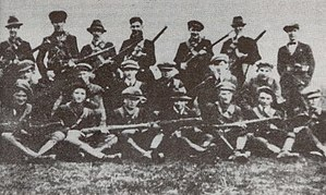 "Irish Republican Army - Flying Column No. 2 of the 3rd Tipperary Brigade of the Old IRA, photographed in 1921. All organisations calling themselves ""Irish Republic Army"" claim legitimate descent (sometimes compared to apostolic succession) from the IRA of 1917–22."