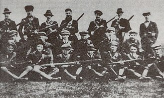 """Irish Republican Army - Flying Column No. 2 of the 3rd Tipperary Brigade of the Old IRA, photographed in 1921. All organisations calling themselves """"Irish Republic Army"""" claim legitimate descent (sometimes compared to apostolic succession) from the IRA of 1917–22."""