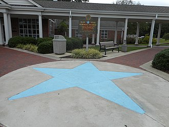Blue Star Memorial Highway - A paved blue star and historical marker at the southbound I-95 Welcome Center in Pleasant Hill, NC