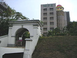 Klang Municipal Council building with old Raja Mahadi fort's gate in the foreground.
