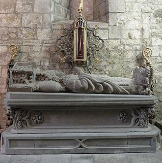 Saint-Brieuc Cathedral - The tomb of Saint-Guillaume Pinchon, Bishop of Saint-Brieuc from 1220 to 1224. Note the elaborate reliquary above the gisant. Also, the two bishop's crooks fixed to the wall