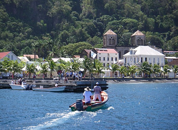 "Saint-Pierre. Before the total destruction of Saint-Pierre in 1902 by a volcanic eruption, it was the most important city of Martinique culturally and economically, being known as ""the Paris of the Caribbean"". Saint-Pierre, Martinique (seen from the harbor - 2005-06-15).jpg"