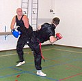 Sanshou (San da) - kick (practice fight) Katwijk, dec 4, 2006.JPG
