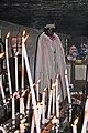 Sara et ses cierges dans la crypte de ND de la Mer.jpg