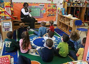 Primary education in the United States - A teacher and her students in an elementary school classroom