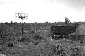 SCR-584 radar - Field deployment of the SCR-584 on Peleliu during World War II. The high elevation angle of the dish combined with a lack of visible activity suggests that the radar is in its helical scan mode.