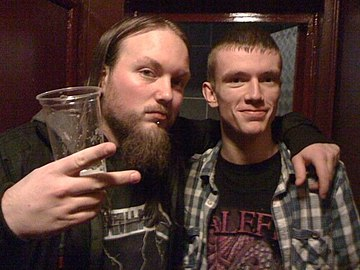 Dale Butler (left) of Malefice, with a fan, 2010 Sean and Dale Butler.jpg