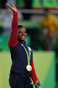 Simone Biles at the 2016 Olympics all-around gold medal podium (28262782114).jpg
