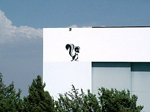 Skunk Works - The Skunk Works logo as seen on one of Lockheed Martin's hangars.