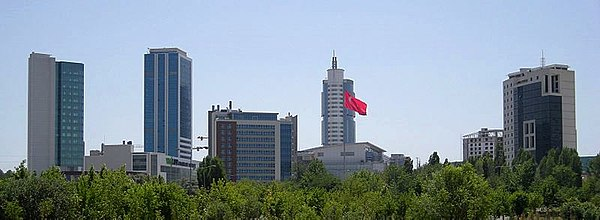 Sogutozu business district in Ankara, as seen from the Ataturk Forest Farm and Zoo, with the Armada Tower & Mall (2002) rising behind the Turkish flag. Sogutozu Ankara Turkey.jpg