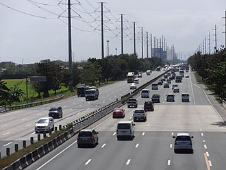 South Luzon Expressway - South Luzon Expressway in Carmona. The Bay-Biñan transmission line of NGCP and LIIP-ROHM subtransmission line of Meralco can be seen on its sides.