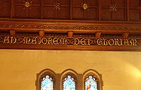 A.M.D.G. engraving in choir loft of St. Ignatius Church, Chestnut Hill, Massachusetts adjacent to the campus of Boston College