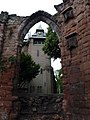 St John the Baptist Parish Church, Chester - present clock tower viewed through window in remains of former east end east of present building 01.jpg