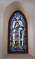 Stained glass window in the Galyatető Roman Catholic church with Saint Stephen.jpg