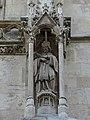 Statue Johannes Nepomuks am Nordturm der Votivkirche II.jpg