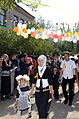 Students in their last year of school escort first-year students to class during a First Bell ceremony in Niznechuiskiy village, Kyrgyzstan, Sept 120901-F-ER469-155.jpg