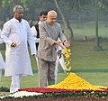 Sushilkumar Shinde paying floral tributes at the Samadhi of former Prime Minister, Late Smt. Indira Gandhi, on her death anniversary, at Shakti Sthal, in Delhi. The Union Minister for Textiles.jpg