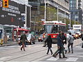TTC streetcar visible by Dundas Square, 2015 12 01 (11) (23184072950).jpg