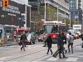 TTC streetcar visible by Dundas Square, 2015 12 01 (11) (23184072950).jpg