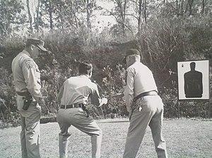 Arlington County Police Department - ACPD policemen practicing marksmanship skills in 1968.