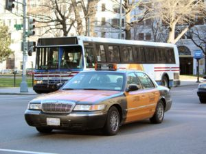 Transportation in Washington, D.C. - A taxicab and a Metrobus cross the intersection of 15th and I Streets NW in downtown Washington, D.C. in January 2006.