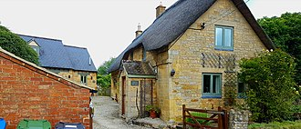 Cotswolds - Some of the stone cottages feature thatched roofs although slate is now more common; (Stretton-On-Fosse)