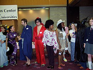 "Costume party - Contestants line up for a ""best costume"" competition at a Halloween party in the United States."