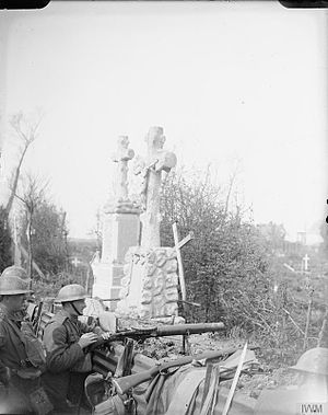 Queen's Own Royal West Kent Regiment - Troops of the 10th (Service) Battalion, Queen's Own (Royal West Kent) Regiment manning a Lewis machine gun in a front line trench running through a cemetery in the Ypres Salient, Belgium, 29 April 1918.