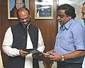 The Minister of State for Information & Broadcasting, Shri M. H. Ambareesh giving a memorandum to the Minister of State for Railways, Shri Naranbhai Rathwa in New Delhi on November 23, 2006.jpg