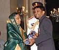 The President, Smt. Pratibha Devisingh Patil presenting the Padma Shri Award to Shri Kumar Ram Narain Karthikeyan, at the Civil Investiture Ceremony-II, at Rashtrapati Bhavan, in New Delhi on April 07, 2010.jpg