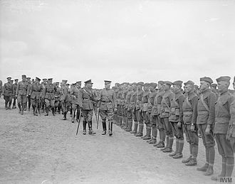 30th Infantry Division (United States) - King George V and Major General Edward Mann Lewis inspecting troops of the 30th Infantry Division, 6 August 1918. Photograph possibly taken at Achicourt, France.