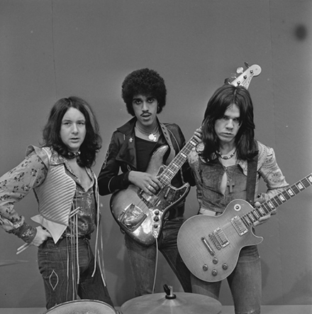 Thin Lizzy in early 1974. Left to right: Brian Downey, Phil Lynott, Gary Moore. Thin Lizzy - TopPop 1974 1.png