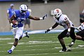 U.S. Air Force Academy (USAFA) sophomore Jon Lee, left, gains yardage against Idaho State Bengals linebacker Demetrius Allen as the USAFA Falcons defeated the Bengals 49-21 at Falcon Stadium in Colorado Springs 120901-F-ZJ145-651.jpg