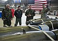 U.S. Air Force Capt. Warren Smith, right, the maintenance operations officer in charge of the 52nd Maintenance Group, explains F-16 Fighting Falcon weapon capabilities to members of the Romanian air force during 140325-F-NJ596-064.jpg