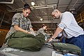 U.S. Air Force Staff Sgt. Esmeralda Ayala, left, and Senior Airman Michael DeMarco, both with the 108th Wing, New Jersey Air National Guard, perform an inventory of DeMarco's equipment May 22, 2013 130522-Z-AL508-007.jpg