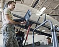 U.S. Air Force Staff Sgt Corey Eckel teaches Airman Michael Stiffler, both with the 364th Training Squadron, how to remove and install hydraulic components on an F-15 Fighting Falcon aircraft at Sheppard Air 110923-F-NF756-005.jpg